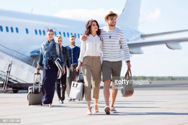 disembarking passengers on runway - izusek stock pictures, royalty-free photos & images