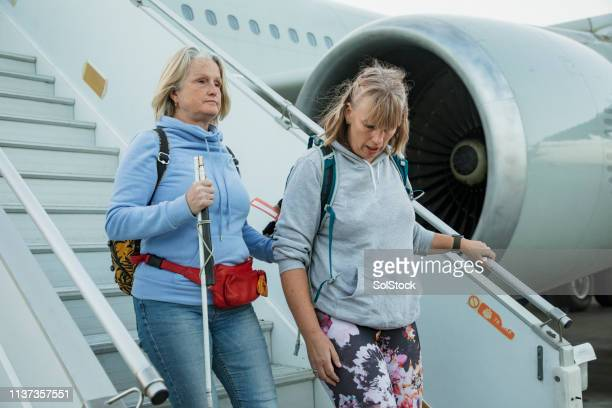 disembarking the airplane - disabilitycollection stock pictures, royalty-free photos & images