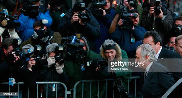 Disgraced financier Bernard Madoff exits a car as he arrives at court March 12 2009 in New York City Madoff was expected to plead guilty to all 11...