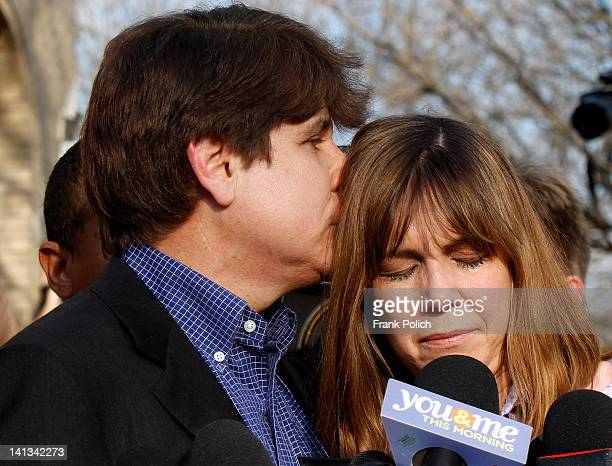 Disgraced former Illinois Governor Rod Blagojevich kisses his wife Patti during a news conference outside his home March 14 2012 in Chicago...