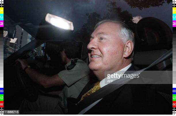 Disgraced formerAustralian tycoon Alan Bond leaves the Supreme Court of West Australia in a prison van after pleading guilty to two charges relating...