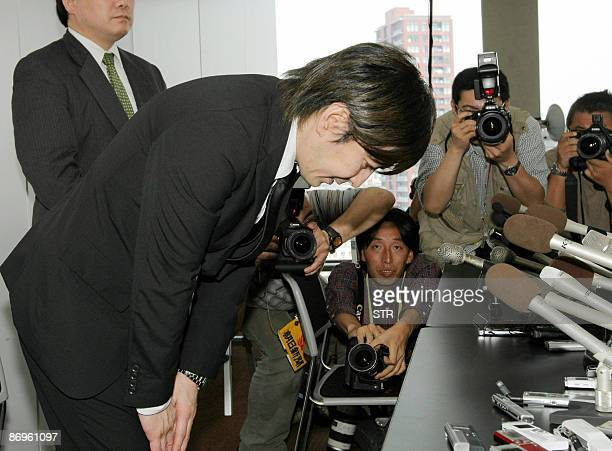 Disgraced Japanese music producer Tetsuya Komuro one of the most successful in Japan's pop music history who now is accused of fraud bows his head at...