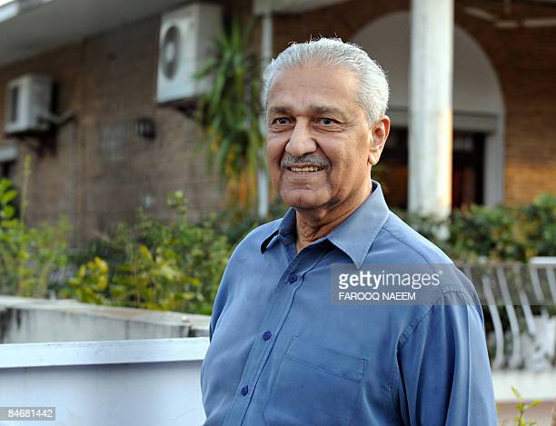 Disgraced Pakistani nuclear scientist Abdul Qadeer Khan waves as he walks in a garden in Islamabad on February 7 2009 Pakistan sought to allay...