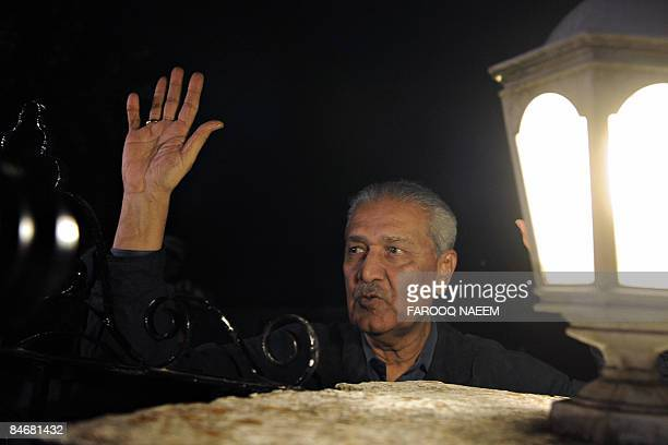 Disgraced Pakistani nuclear scientist Abdul Qadeer Khan waves to supporters from his residence in Islamabad on February 7 2009 Pakistan sought to...