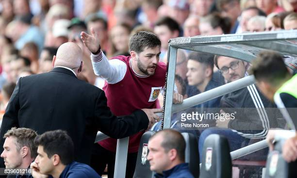 A disgruntled Northampton Town fan makes his point to the home bench after seeing his sides lose during the Sky Bet League One match between...