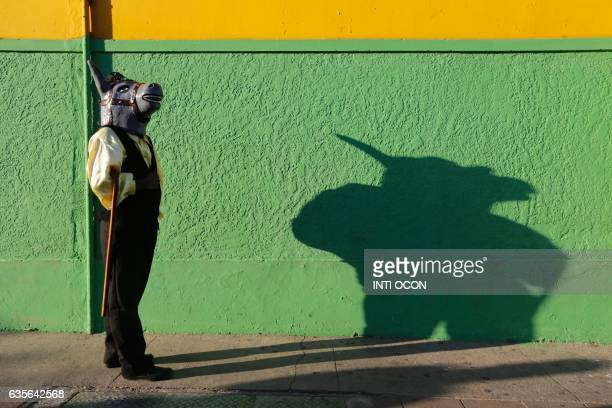 TOPSHOT A disguised dancer takes part in the XIII Poetry Festival in Granada some 45 kilometres from Managua on February 15 2017 Poets from America...
