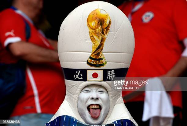 TOPSHOT A disguised Japanese fan sticks out his tongue before the Russia 2018 World Cup Group H football match between Colombia and Japan at the...