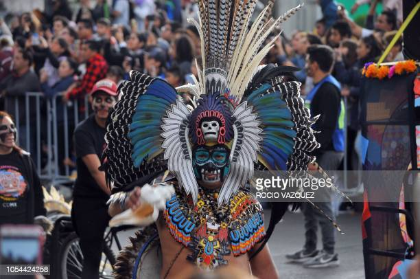 A disguised man parades during the Day of the Dead celebration in the third Big Parade in Mexico City on October 27 2018 The parade is promoted by...