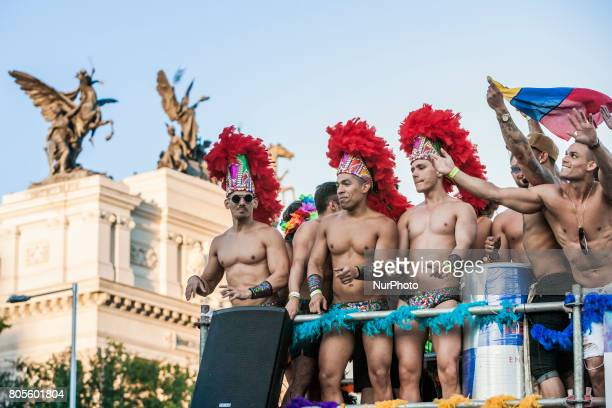 Disguised participants in the celebrations of the World Pride 2017 in a carriage in the streets of Madrid Spain