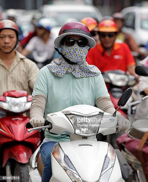 Disguised scooter driver in Ho Chi Minh City on November 01 2016 in Ho Chi Minh City Vietnam