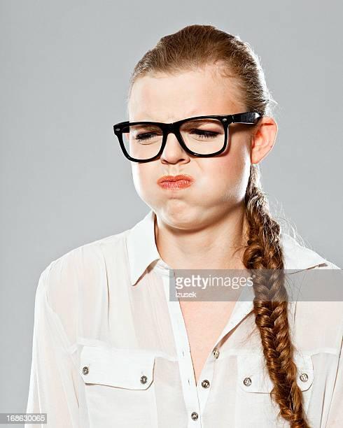 disgusted woman, studio portrait - afkeer stockfoto's en -beelden