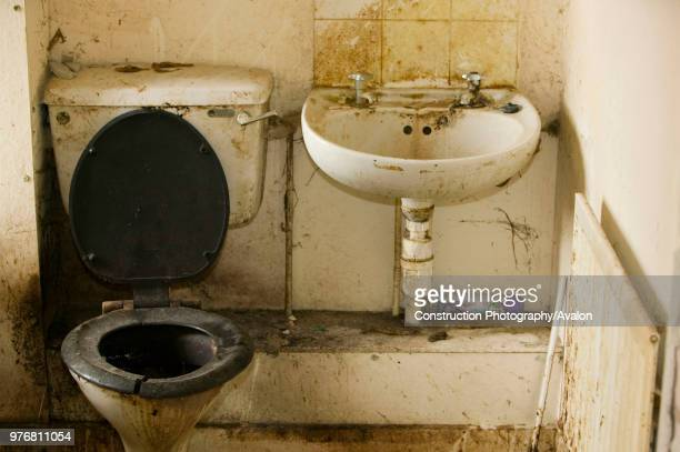 Disgustingly dirty bathroom in an abandoned council house in Carlisle Cumbria UK.