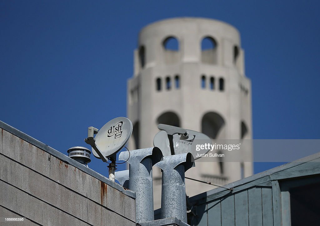 A Dish Network satellite dish (L) is mounted next to a DirecTV dish on the roof of an apartment building on April 15, 2013 in San Francisco, California. Dish Network Corp has offered to purchase Sprint Nextel Corp for $25.5 billion in cash and stock.