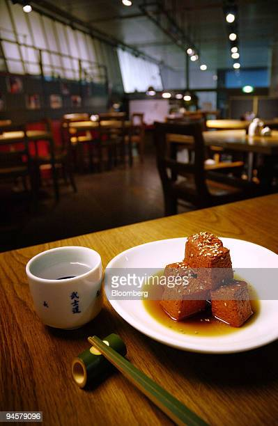 A dish of Konjak is arranged with a glass of Sake in Takara restaurant at the Tokyo International Forum in Tokyo Japan on Monday Oct 22 2007 Takara...