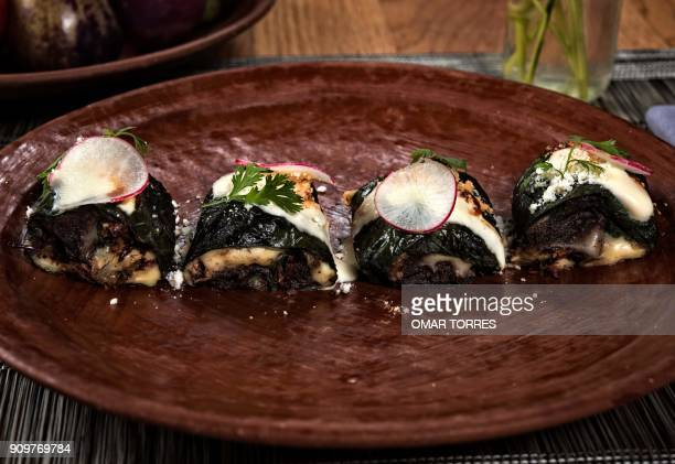 A dish of little tacos of Piper auritum stuffed with Oaxaca cheese chapulines beans Morita chili sauce and radish is seen at Mexican chef Alejandro...