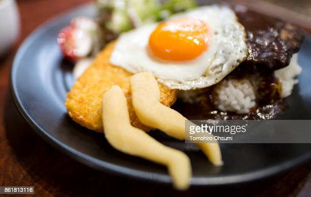 A dish of loco moco with a female thigh shaped marzipan is served inside the Thigh Photo Cafe Tokyo on October 16 2017 in Tokyo Japan This popup...