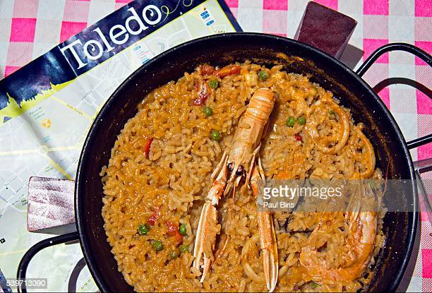 A dish of paella, served in a restaurant, Toledo, Spain
