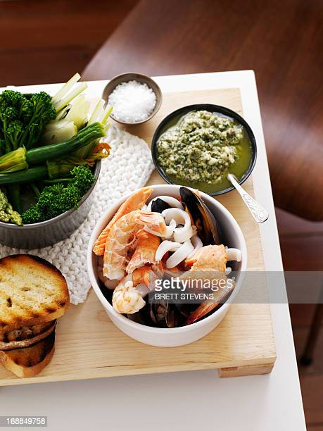 Dish of prawns with bread and vegetables
