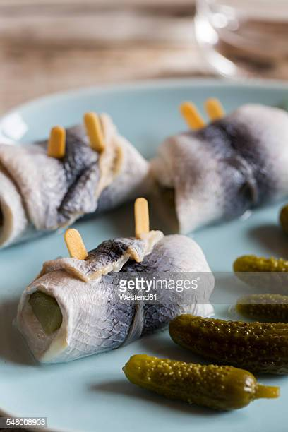 Dish of rollmops and pickled cucumbers
