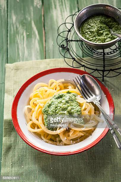 dish of rutabaga noodles with fresh homemade pesto - rutabaga stock pictures, royalty-free photos & images