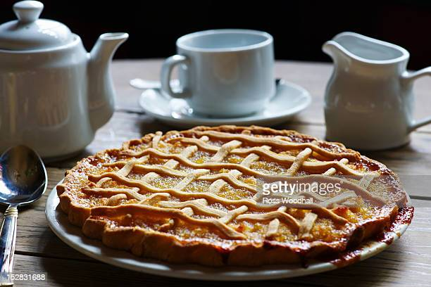 Dish of treacle tart with coffee
