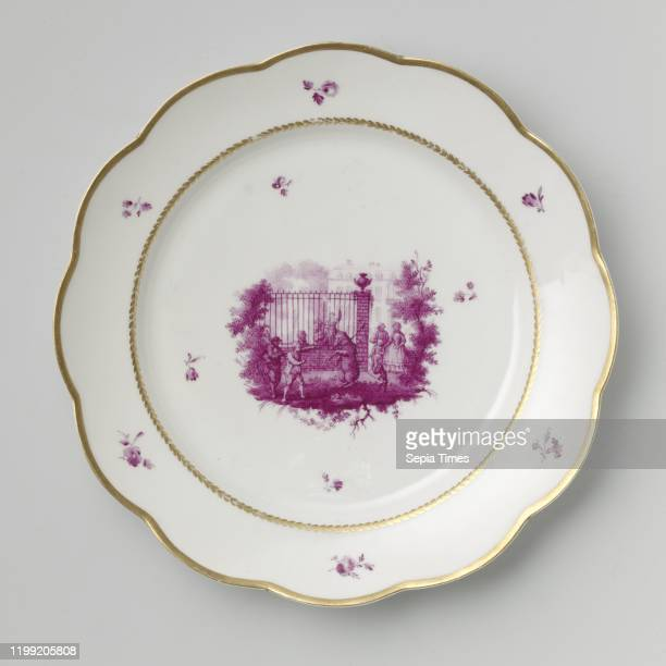 Dish or plate with dancing bear Plate Of porcelain Painted in beet red with a bear in the middle of the shelf that must show its skills to bystanders...