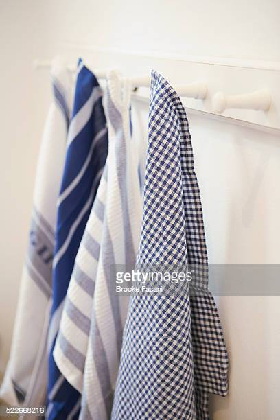 Dish towels hanging on pegs