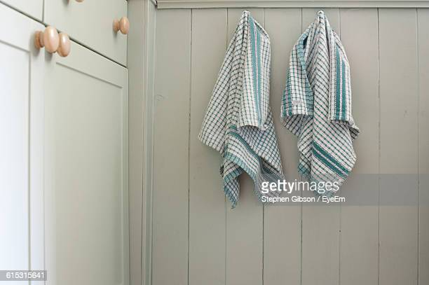 dish towels hanging on wooden wall in kitchen at home - dish towel stock pictures, royalty-free photos & images