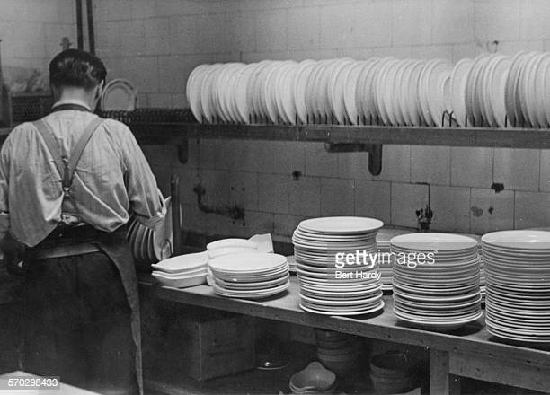 A dish washer at work in the kitchens of the Grand Hotel in Torquay Devon August 1947 Original Publication Picture Post 4418 Grand Hotel pub 30th...