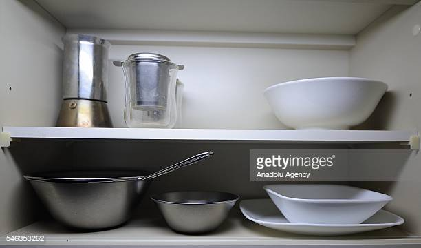 Dishes and a small teapot are seen in a kitchen cupboard in the apartment of minimalist Fumio Sasaki in Tokyo Japan on June 24 2016 Fumio Sasaki...