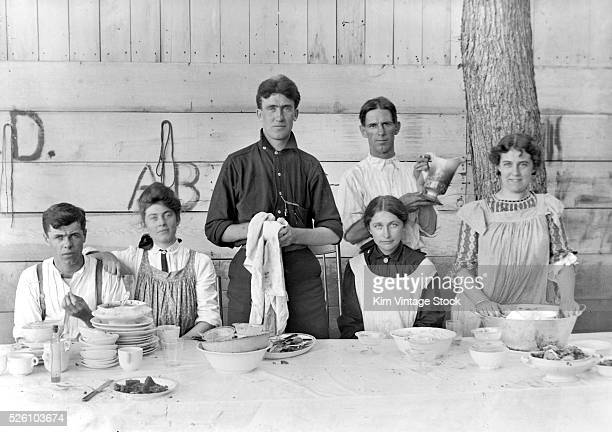 Dishes are cleared after a dinner party, ca. 1905