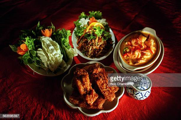 Dishes at Maithai Thai Restaurant on are clockwise from left Vegaetables for Nam Kow Tod dish Nam Kow Tod dish Pineapple Shrimp Curry and Fried...
