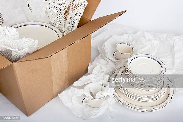 dishes being securely packed away - crockery stock pictures, royalty-free photos & images