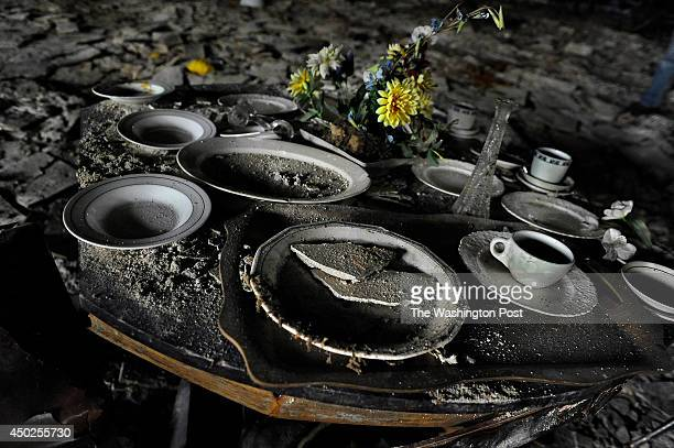 Dishes in the banquet area of the basement in a rotting church Detroit Detroit has tens of thousands of blighted abandoned and burnedout structures A...