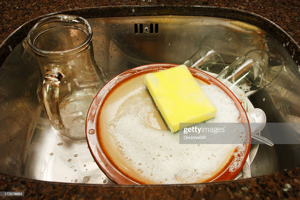 Dishes in the sink : Stock Photo