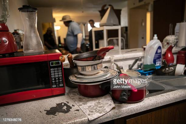 Dishes lie piled in an apartment as a eviction order is served on September 30, 2020 in Glendale, Arizona. Thousands of court-ordered evictions...