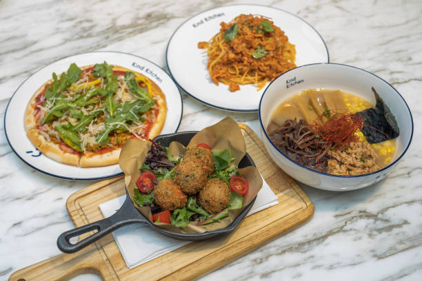 Dishes made with plant-based omnipork are arranged for a photograph at the Kind Kitchen restaurant, operated by Green Monday, in Hong Kong, China, on...