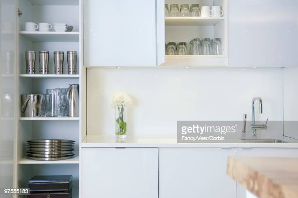 Dishes Organized in Kitchen Cabinets