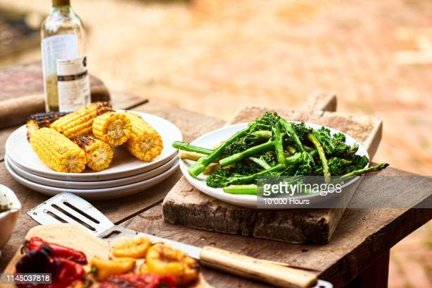 dishes with freshly prepared green vegetables and sweetcorn - food state stock pictures, royalty-free photos & images