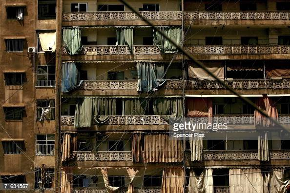 Disheveled balcony curtains hang from an abandoned apartment ...