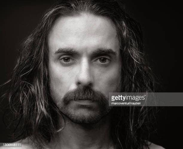 disheveled portait of man with long hair - marcoventuriniautieri stock pictures, royalty-free photos & images