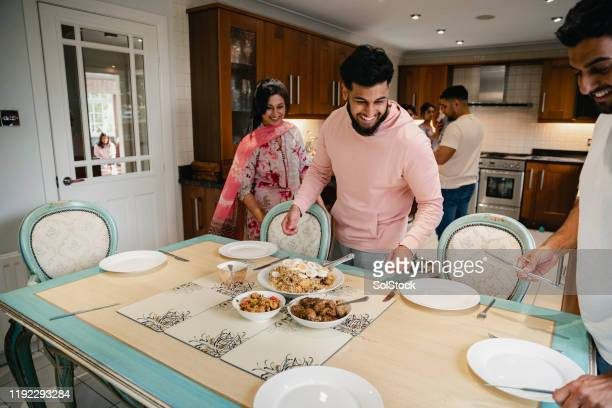 dishing out the family dinner - asian stock pictures, royalty-free photos & images