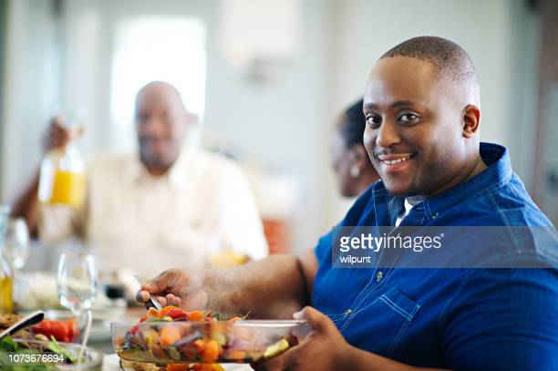 dishing those vegetables looking at camera - heavy stock pictures, royalty-free photos & images
