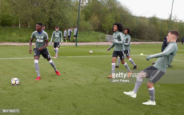 Di'Shon Bernard D'Mani BughailMellor and Lee O'Connor of Manchester United U18s in action during an U18s training session at Aon Training Complex on...