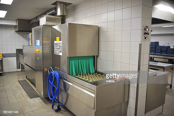 dishwasher in commercial kitchen - commercial cleaning stock photos and pictures