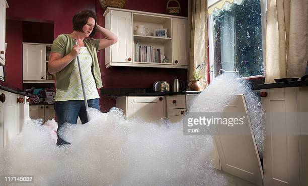 dishwasher malfunction - flooding stock photos and pictures