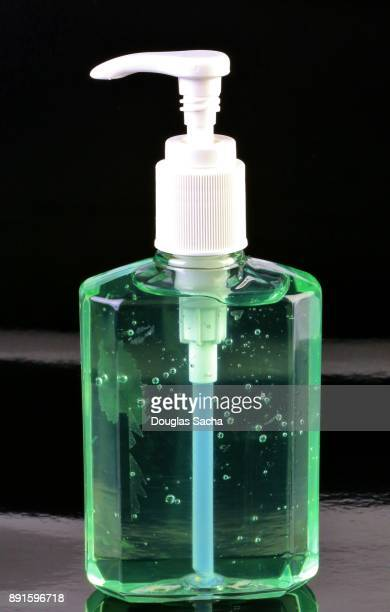 disinfectant gel in a ready use bottle for antibacterial hand washing - squirt foto e immagini stock