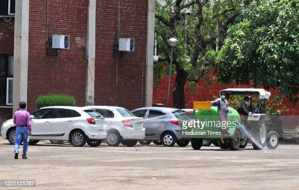 Disinfectant is being sprayed to sanitizethe CCET campus at the end of registration for migrant travellers at Sector 26 on June 19 2020 in...