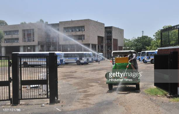 Disinfectant is sprayed to sanitizethe CCET campus at the end of registration for migrant travellers at Sector 26 on June 19 2020 in Chandigarh...