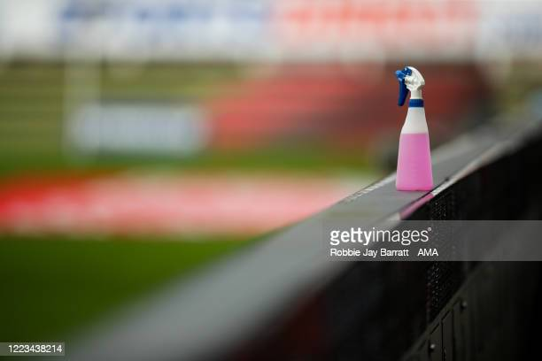 A disinfectant spray is seen pitch side on a sponsor board ready for disinfecting the match balls due to Coronavirus during the FA Cup Quarter Final...